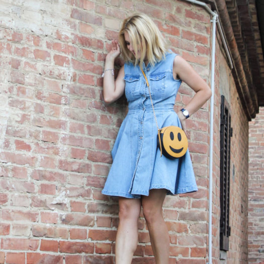 A chemisier denim dress and a smiley face